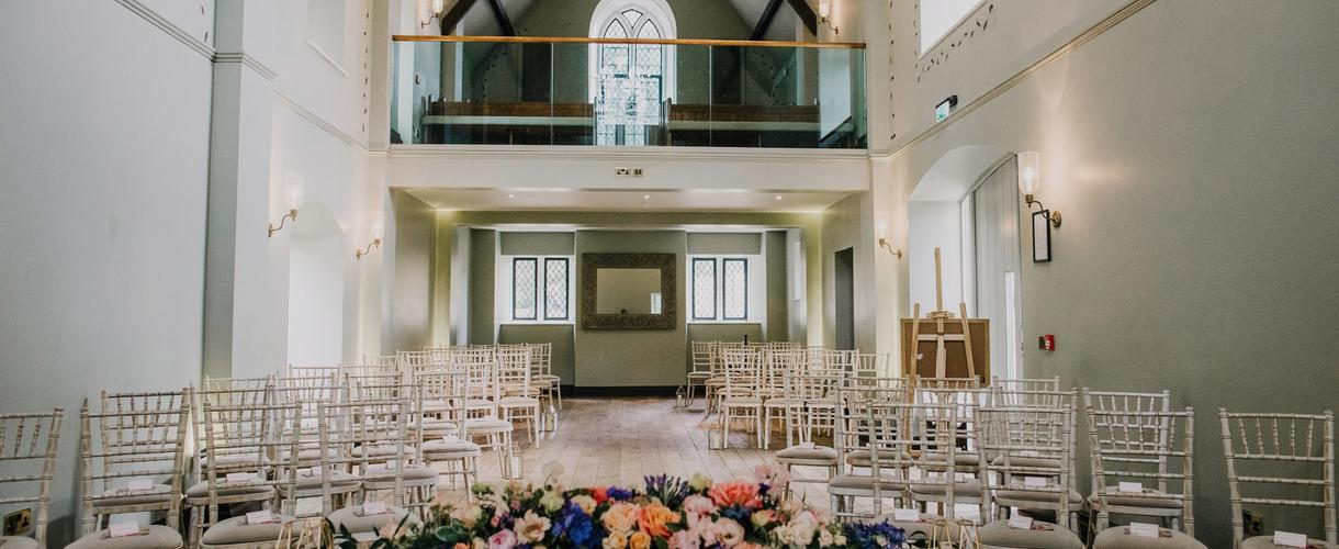 this is a photo of a wedding ceremony set up in a church with colourful flower decorations
