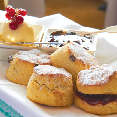 this is a photo of a platter of scones with jam and cream