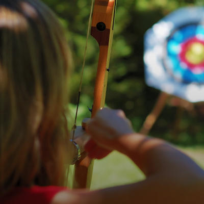 a photo of a woman playing archery