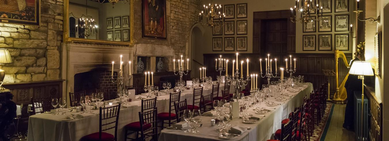 a photo of the great hall set up for an exclusive dinner