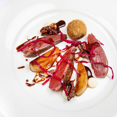 a photo of a duck fine dining dish
