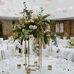 this is a photo of a wedding reception with pink and white balloons and flower arrangements on the tables
