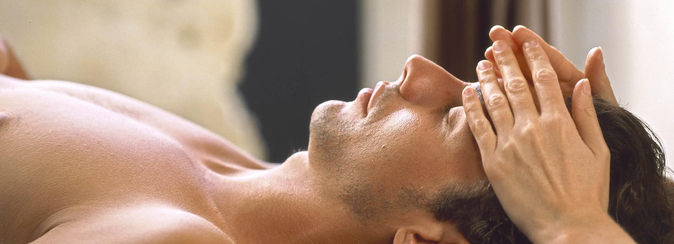 a photo of a man enjoying a facial massage