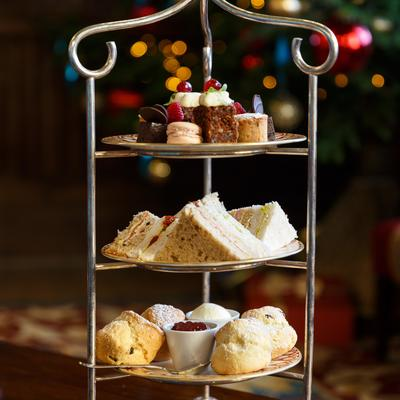 afternoon teas selection with christmas tree behind