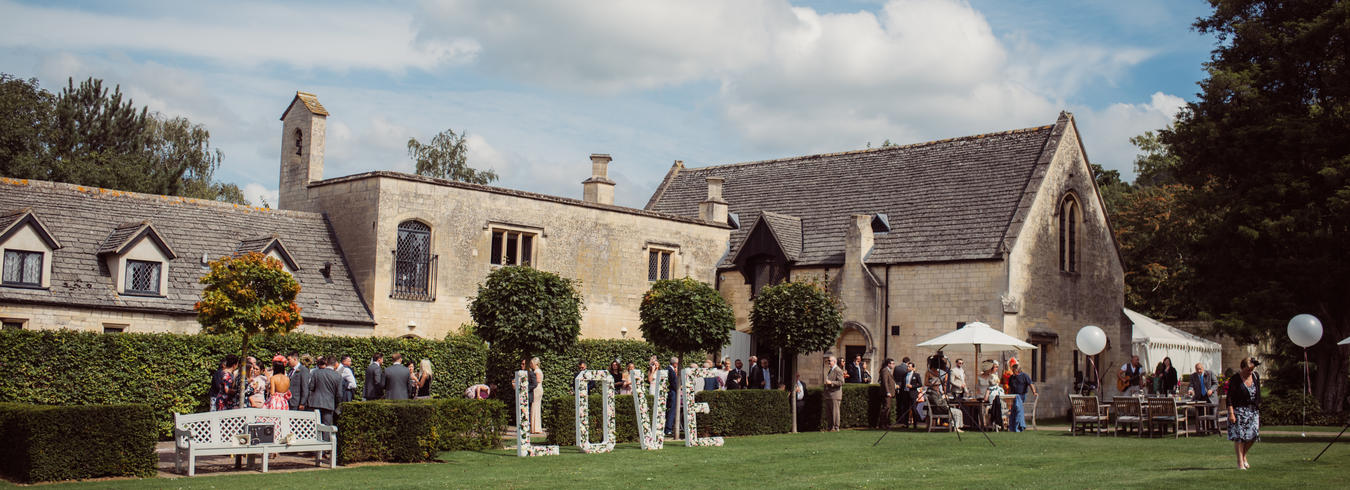 a photo of a wedding party reception in the hotel grounds