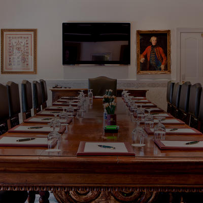 A photo of a meeting table in the Boardroom