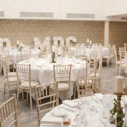 this is a photo of a wedding reception with a mr & mrs light sign