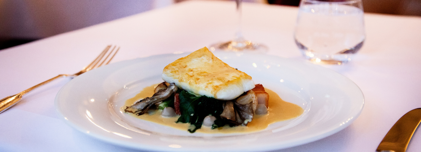 a photo of a fish dish from the Fine dining restaurant