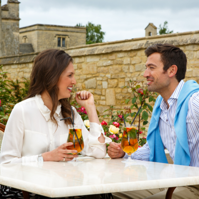 this is a photo of a couple enjoying a pimms in the garden area