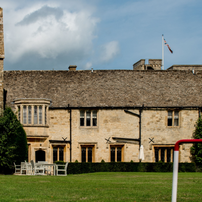 this is a photo of the outside of ellenborough with a game of croquet