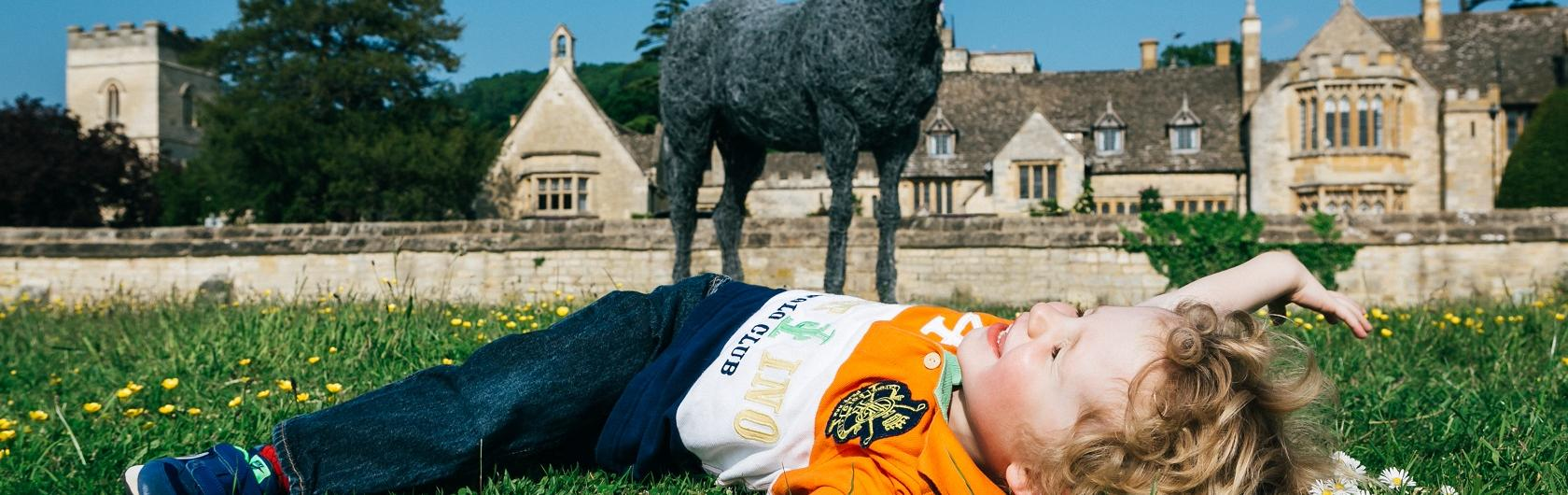 Child in front of Cotswold hotel