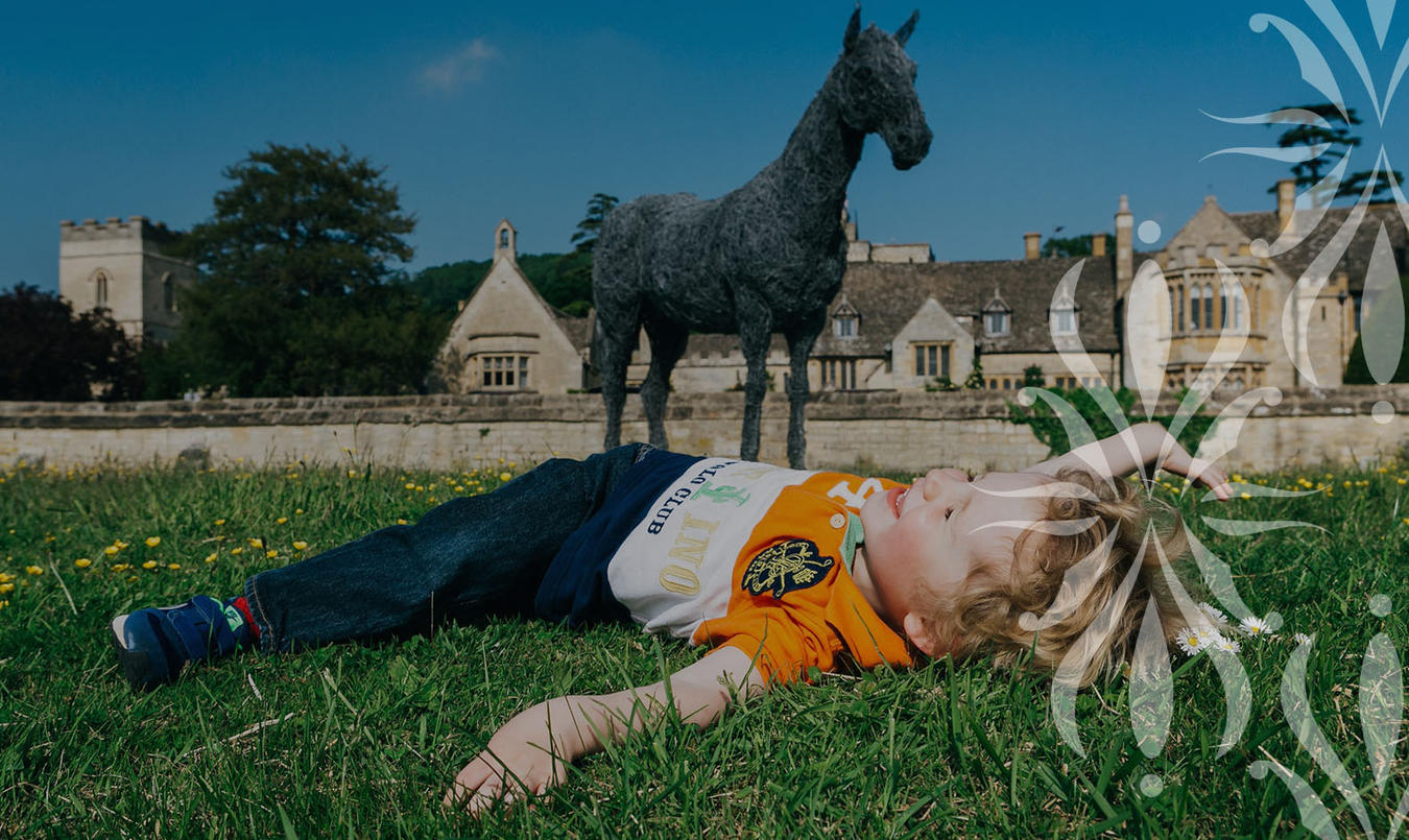 Child in front of Cotswolds hotel