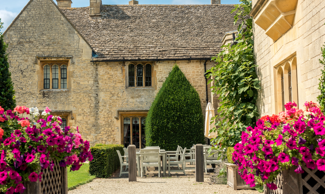 this is a photo of the outside of ellenborough with a garden dining area