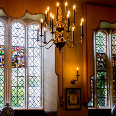 this is a photo of two large stain glass windows in the great hall
