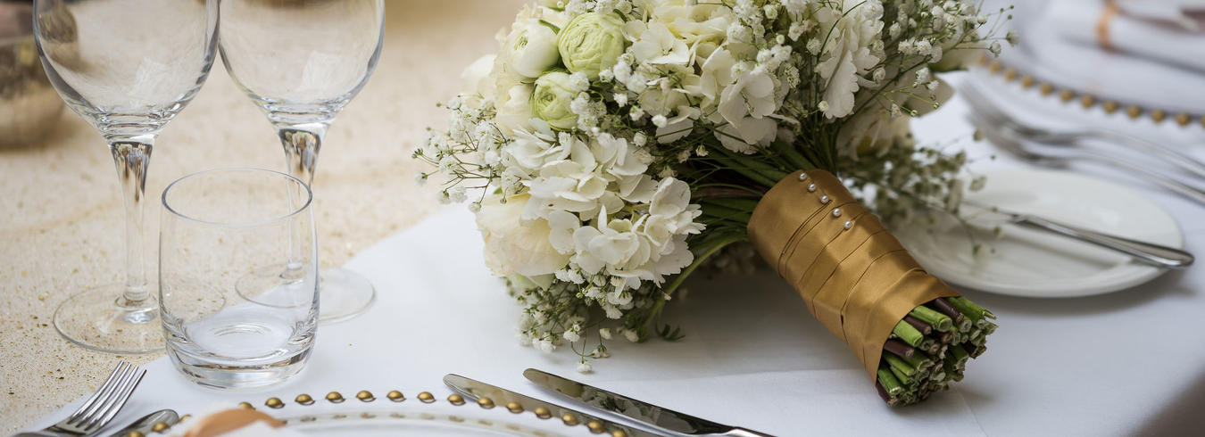 a photo of a wedding bouquet on dining table