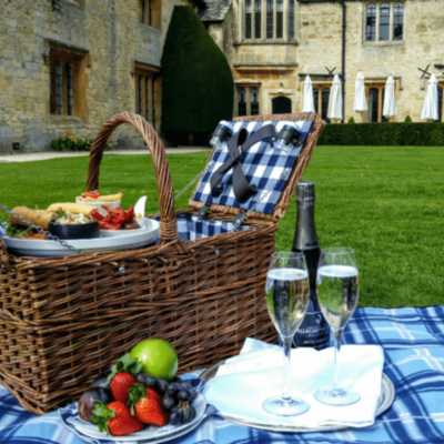 this is a photo of a champagne picnic outside of ellenborough park